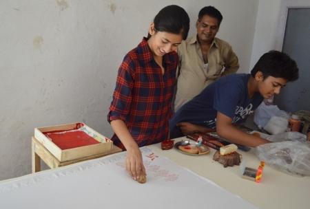 Devena's daughter Shivangali prints a paisley design.