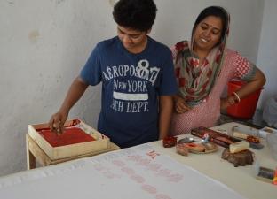 Devena's son Mritunjay printing a camel.
