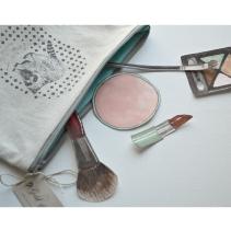 raccoon make up bag with make up